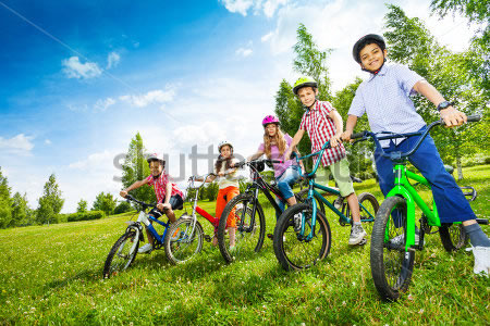 stock-photo-row-of-children-in-colorful-helmets-holding-bikes-210546154_tmp
